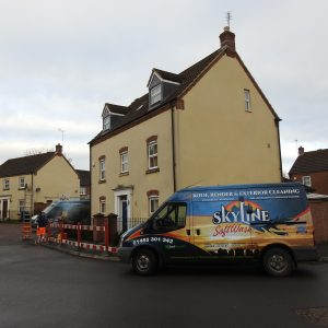 SkyLine SoftWash van at side of house which is having a SoftWash Treatment