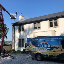 Use of Cherry Picker cleaning a roof in Cheltenham